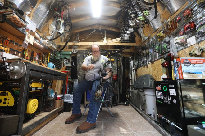 Chris Dellinger works on a bow in his shop, Raven Hill Archery Works. The cozy but well-equiped shop is located near Adams Mills, north of Dresden.