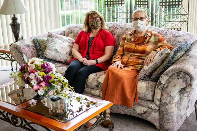 Jill Bednarczuk, left, and Beth Fineran, sit together at First Christian Church in Zanesville nearly a year after beginning the kidney transplant process together.