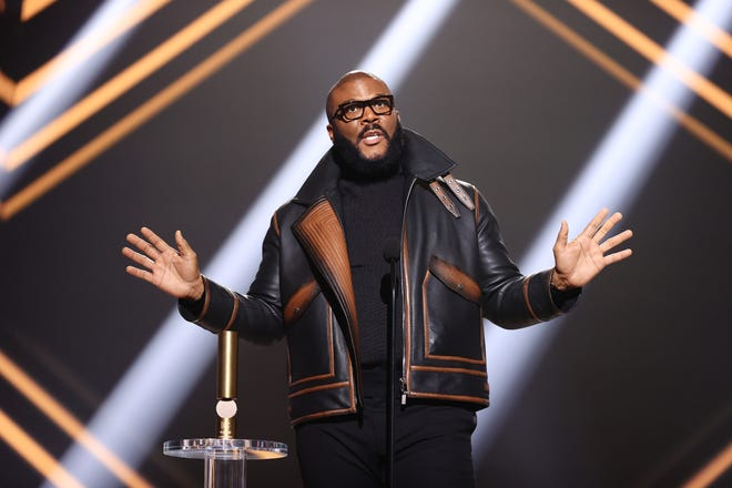 Tyler Perry, here at the People's Choice Awards on Nov. 15, gave away food to 5,000 Atlanta-area families this weekend.
