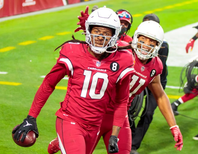 Arizona Cardinals wideout DeAndre Hopkins celebrates his game-winning touchdown against the Bills on Sunday. The Thursday night matchup between the Cardinals and Seahawks could be a shootout.