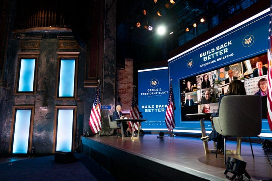 President-elect Joe Biden and Vice President-elect Kamala Harris attend a briefing on the economy at The Queen theater Nov. 16, 2020, in Wilmington, Del.