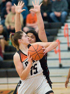 Marlington's Allison Lacher looks for a shot against Alliance in a game in February 2020. Lacher is a returning starter for the Dukes.