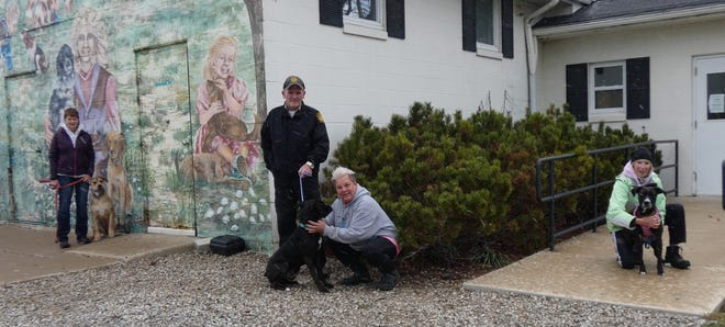 Dianne Hammontree of Homeward Bound Dog Shelter, Ashland County Dog Warden Joe Eggerton, kennel manager Krissi Fussner and volunteer Veronica Negrey of No Pawz Left Behind, from left, stand outside the Ashland County Dog Shelter with three adoptable dogs.