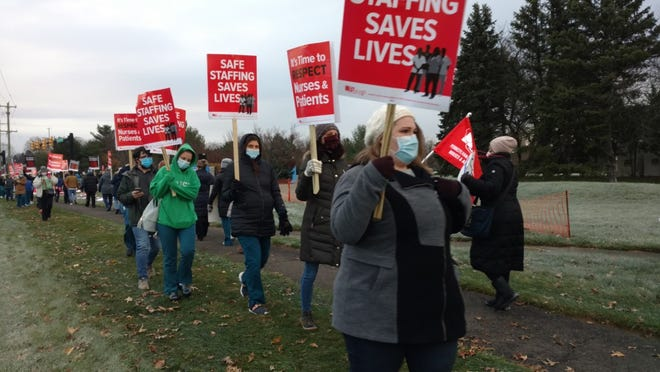 FILE: St. Mary Medical Center nurses strike outside the Middletown hospital Tuesday morning.
