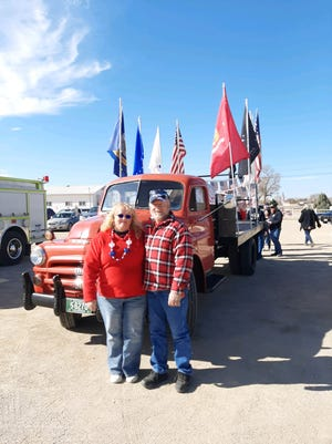 "Kathleen Tomlin calls this couple, Doug and Missy Ricken, ""Mr. & Mrs. Patriotic."" They are always ready for a patriotic parade at the drop of a hat and are glad to lead things with their 1951 Dodge Flatbed Truck."