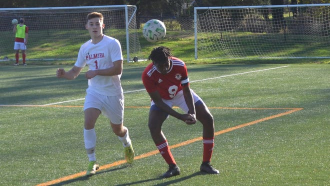 Palmyra junior Chris McCarron (1) watches Iyshon Williams of Penns Grove play a header during Monday's playoff game. McCarron scored three times in Palmyra's 5-1 win.