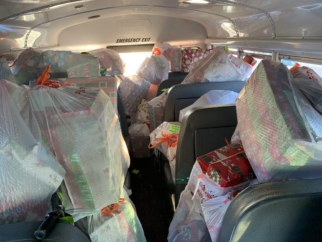A bus donated by Frye Transportation Group Inc. is stuffed with new toys that were donated to needy families last year in an annual holiday campaign organized by Coffee Beanery in Center Township.