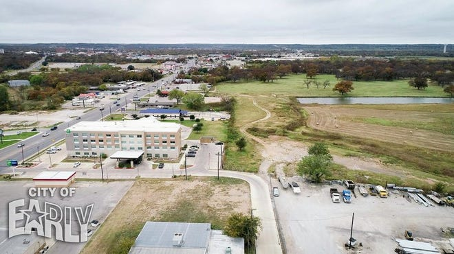 An aerial view looking west down Early Boulevard shows a portion of the site where a town center in Early is proposed.
