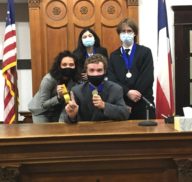Brownwood Debate students after receiving awards. Mo Goff (center), Ava Sparks-Hansen (left), Kali Alvizo (back center), Nickolas Guerrero (right).