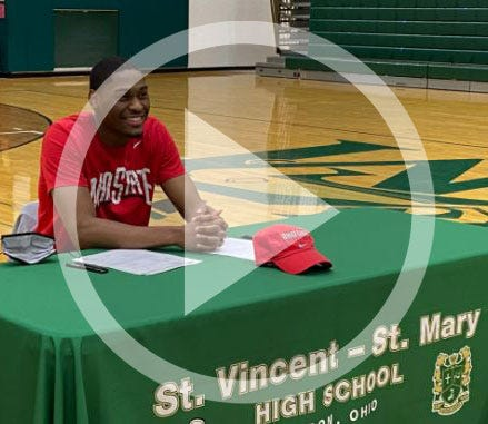 In this file photo, Malaki Branham smiles after officially signing to play college basketball at Ohio State during a November 13, 2020 press conference at Akron St. Vincent-St. Mary High School.