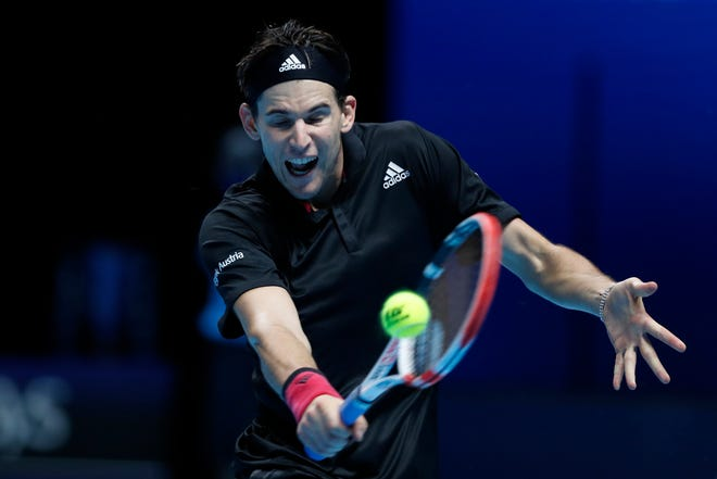 Dominic Thiem plays a return to Rafael Nadal during the ATP finals in London on Tuesday.