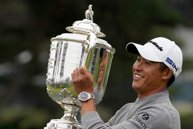 Collin Morikawa holds the Wanamaker Trophy after winning the PGA Championship tournament at TPC Harding Park in San Francisco on Aug. 9. Morikawa was an example of another youth movement when he won his first major at age 23.
