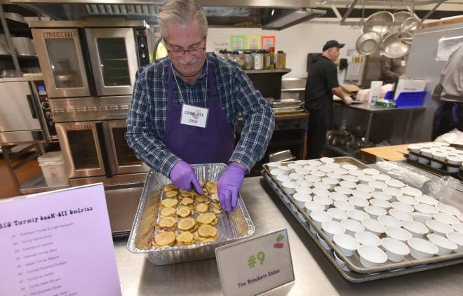 Jim Russo portions out servings of the Brackett Slider, which took grand prize at last year's annual Turnip Fest at Nauset High School.