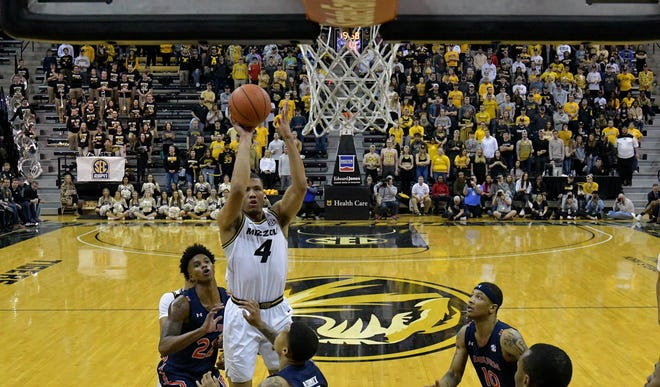 Missouri guard Javon Pickett (4) shoots during a Southeastern Conference game against Auburn on Feb. 15 at Mizzou Arena.