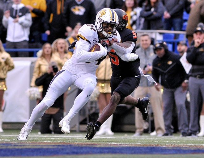 Missouri running back Larry Rountree (34) carries the ball against Oklahoma State during the 2018 Liberty Bowl in Memphis, Tenn.