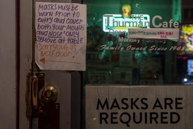 Thurman Cafe along Thurman Avenue in the German Village neighborhood of Columbus, Ohio, displays mask requirement signs to patrons on Nov. 12, 2020.