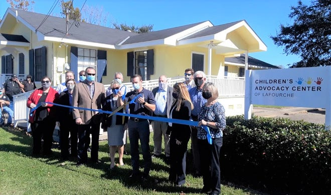 Lafourche Parish officials hold a ribbon-cutting ceremony Tuesday to officially open the District Attorney's Office's new Children's Advocacy Center.