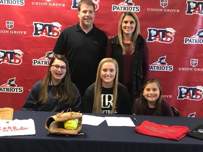 Union Grove's Katelyn Rackard (seated, center) has signed a Letter of Intent to play softball at Lenoir-Rhyne. Pictured with her are sisters Ashley Tori and parents Jon and Amanda Rackard. [Photo by Wes Cromer]