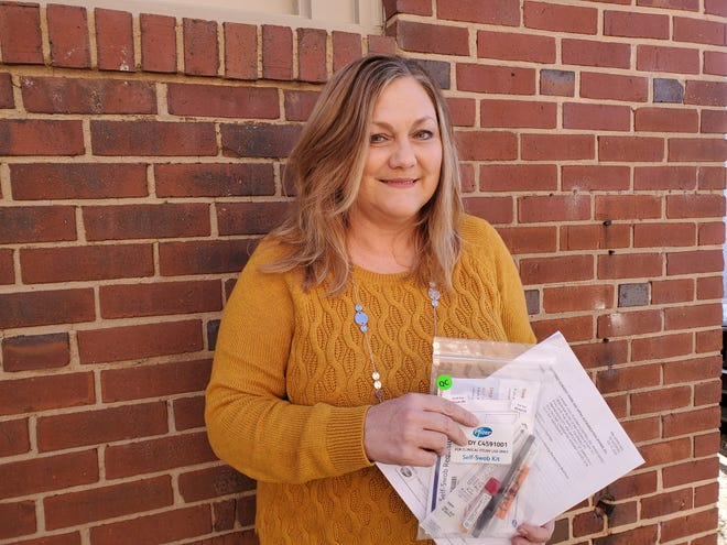 Kim Knouse Richard of Davidson County was one of 450 Piedmont area residents and one of 43,538 total participants in a trial study of the Pfizer vaccine for COVID-19. In the photo, she is holding the 25 pages, informed consent contract she signed to be a part of the study based at PMG Research in Winston-Salem and a swap test she will use if she develops COVID-19 symptoms.