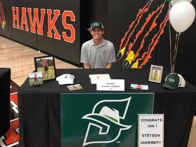 Spruce Creek high golfer Ian Ball celebrates signing his scholarship with Stetson University as 17 Creek athletes signed scholarships last week. Nov. 2020
