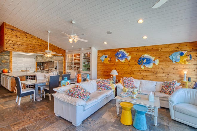 Its nearly 3,000 square feet of living space features vaulted cedar-plank ceilings, built-in shelving, plantation shutters and tongue-and-groove pine.