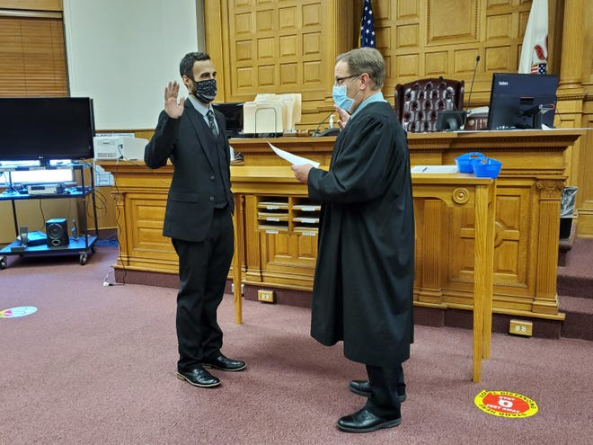 Monmouth native Alexander Whitman, left, was sworn in as assistant state's attorney in Warren County on Monday.