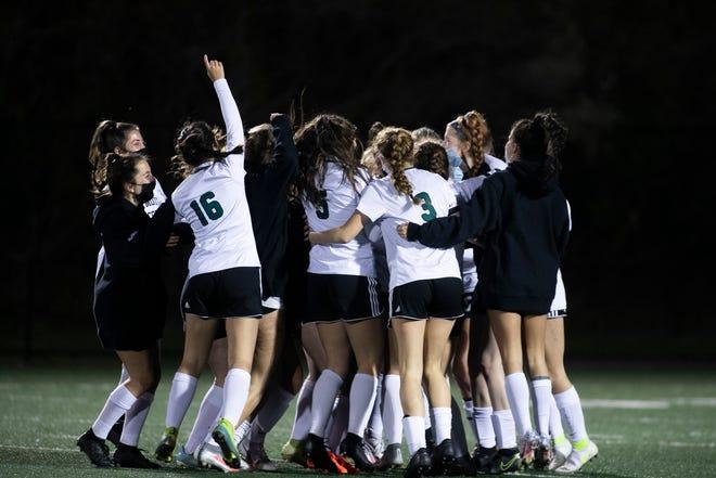 The Dartmouth varsity girls soccer team celebrate after winning the Southeast Conference girls soccer championship, 2-0, against Bridgewater-Raynham at the Bridgewater-Raynham Regional High School on Monday, Nov. 16, 2020.