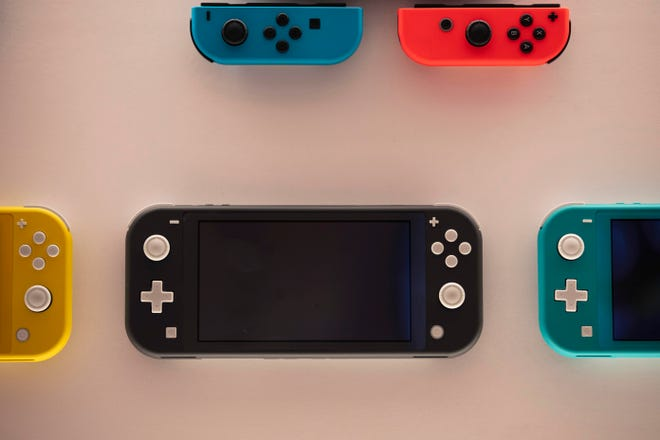 Time spent playing video games can be good for mental health, according to a new study by researchers at Oxford University. The finding comes as video game sales this year have boomed as more people are stuck at home because of the pandemic. Shown here are Nintendo Switch game consoles.