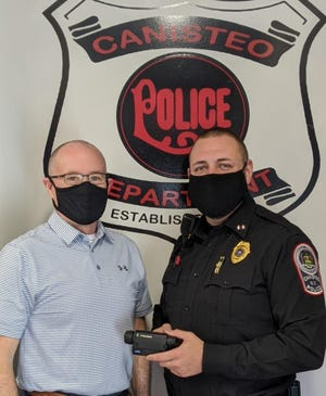 Jeff Ryan of The Ryan Agency, left, with Canisteo Police Chief Kyle Amidon after The Ryan Agency made a donation to purchase a Pulsar Thermal Imaging Unit for the department.