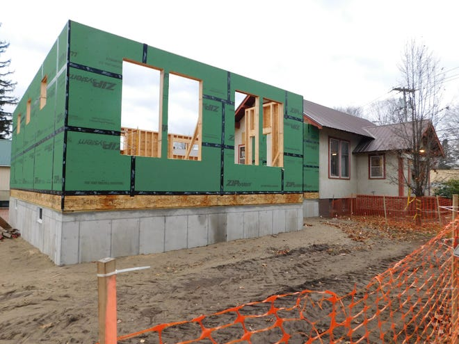 The addition under construction at the Poland Public Library will double the size of the facility. It will include a new children's area, office space and handicapped accessible restrooms while providing more space for shelves and library materials.