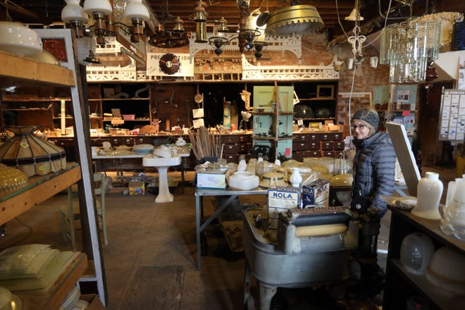 Andrea Riley looks for a globe for a ceiling fan while visiting the Preservation Station, where architectural salvage and an assortment of period items are offered for sale by the non-profit Heritage Trust. Preservation Station will be open from 9 a.m. to 1 p.m. Saturday.