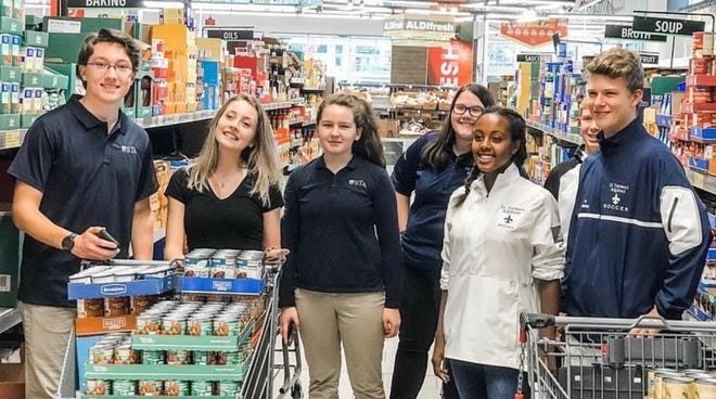Saint Thomas Aquinas students are seen during the 2019 food drive. The 2020 food drive is taking the form of a virtual road race.