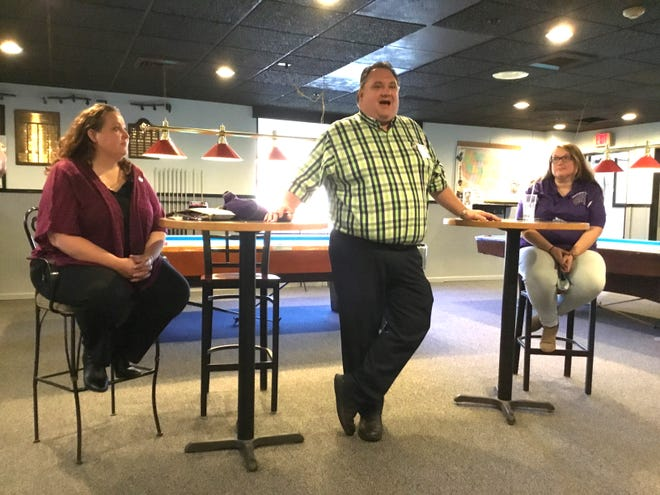 Paul R. Ryan, national leader of the Benevolent and Protective Order of Elks, addresses the members of the Rochester lodge. Shown with him are his wife Stacey, left, and Beth Sanborn, Rochester member and wife of Loyal Knight Matt Sanborn.