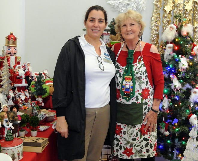 Gina Fiore (left) was in charge of the 30th annual Cultural Center Holiday Shoppes, while Hilah Autrey  was in charge of the Christmas shop.