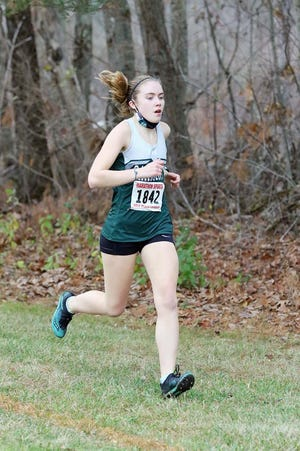 Oakmont's Fiona Picone traversed Quabbin's 3.1-mile course in a record-breaking time of 21 minutes, 17 seconds while taking first place in Monday afternoon's meet against the Panthers in Barre.