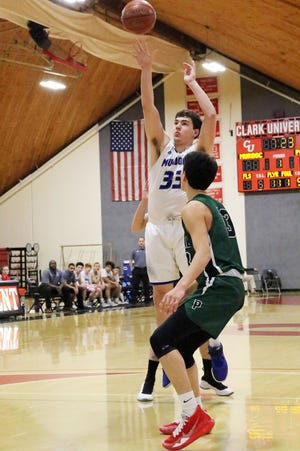 Murdock's Cam Monette shoots a jumper over a Parker Charter School defender during the quarterfinals of the 2019 Clark Tournament at the Kneller Athletic Center in Worcester.