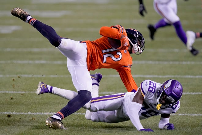 Chicago Bears wide receiver Allen Robinson II (12) catches a pass as Minnesota Vikings cornerback Chris Jones (26) defends during the second half of Monday's game in Chicago. (AP Photo/Nam Y. Huh)