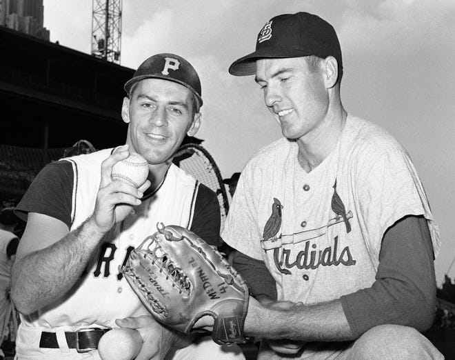 In this Aug. 11, 1960, file photo, shortstop Dick Groat, left, of the Pittsburgh Pirates, and pitcher Lindy McDaniel, of the St. Louis Cardinals, talk at Forbes Field in Pittsburgh. McDaniel, an All-Star reliever who appeared in nearly 1,000 major league games over 21 seasons, has died. He was 84. [AP Photo/File]