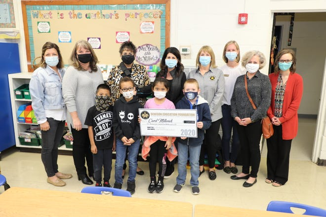 Students at Lamar Elementary pose for a photo with a grant check from the Denison Education Foundation for new C-Pen readers for the school. The grant was among four that was given to teachers throughout the district as a part of the Fall 2020 grant cycle.