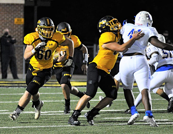 Denison's Seth Fulenchek and Colby Crawley (60) block during the Yellow Jackets' loss against Frisco last week. Denison plays at Lebanon Trail on Thursday night.