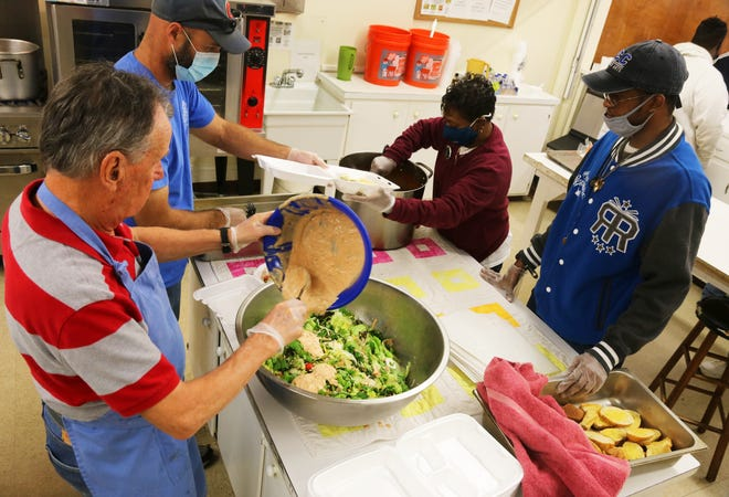 Volunteers at Mary's Kitchen prepare lunches for patrons Tuesday, November 17.