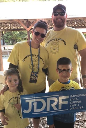 Parents Amy and Bryan McGeary with daughter Rilynn, left, and Cameron McGeary, form team Cameron's Minions to support Cameron's journey with Type 1 diabetes.