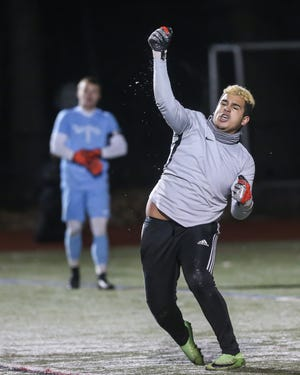 Milford goalie Leo Oliveira reacts after making the game-winning penalty kick save during the Division 2 South sectional finals against Nauset at Milford High School on Nov. 17, 2019. On Monday, Oliveira went down with an injury but still saw his team win a Hockomock League Cup with a victory over Oliver Ames.