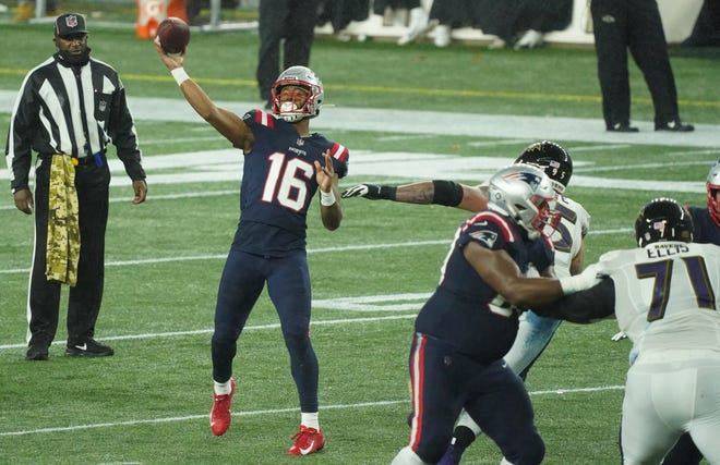 Patriots wide receiver Jakobi Meyers (second left) throws a touchdown pass against the Baltimore Ravens during the second quarter at Gillette Stadium.