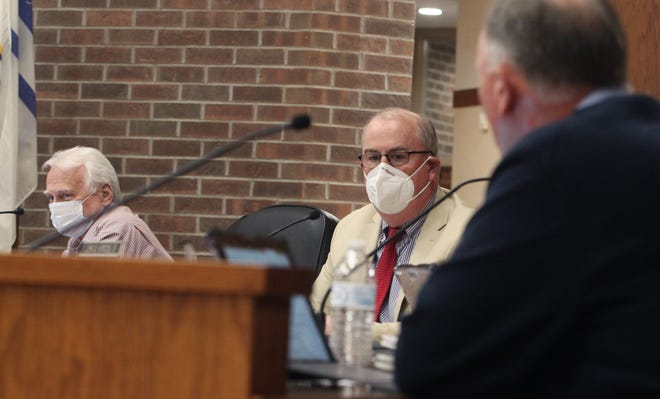 Moberly Mayor Jerry Jeffrey, middle, and councilman Tim Brubacker, left, listen to comments being made by councilman Cole Davis, right, during Monday's city council business meeting.