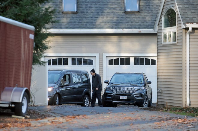 A man leaves the home at 16 Adelaide Ave. in Wayland Tuesday morning Nov. 17, after an apparent murder-suicide at the home discovered Monday night.
