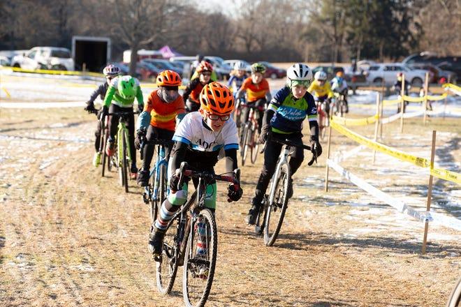 Liam Goff (in orange helmet) barrels down a cyclocross course during the NBX Gran Prix in Warwick's Goddard Park.