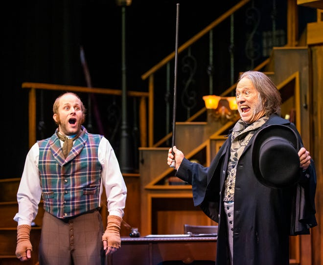 "Alex Dagg, left, playing the part of Bob Cratchit, reacts to Alex Pinkston, right, playing the part of Scrooge, during a dress rehearsal for Ocala Civic Theatre's new show, ""A Christmas Carol."" The show runs from Nov. 19 through Dec. 20."