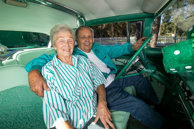 "With the fuzzy dice hanging from the rear view mirror, Kathy and Ritchie Krause sit in their 1956 Ford Crown Victoria, which was purchased in 1990. ""I sold my first '56 Victoria to buy our first house that cost $11,500. I payed $11,000 for this one,"" Ritchie said with a chuckle."