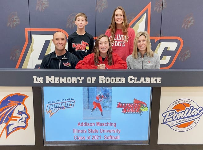 Addison Masching, in middle in front, signed a national letter-of-intent to play softball and continue her education at Illinois State University. Sitting with Masching are her parents Brian, left, and Lindsay Masching. In back are siblings Cayden and Bailey Masching.